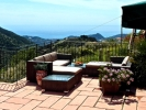 In a panoramic position, about 10 km. from the sea and from Bordighera, part of a semi-detached house with independent e ...